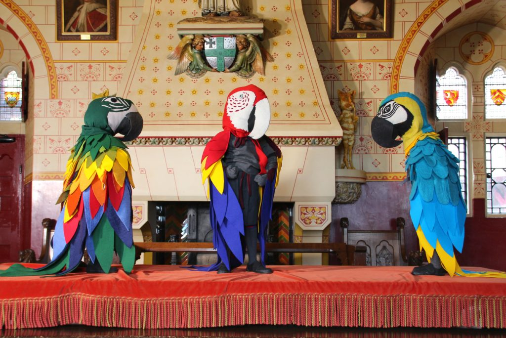 Parrot sculptures on a table