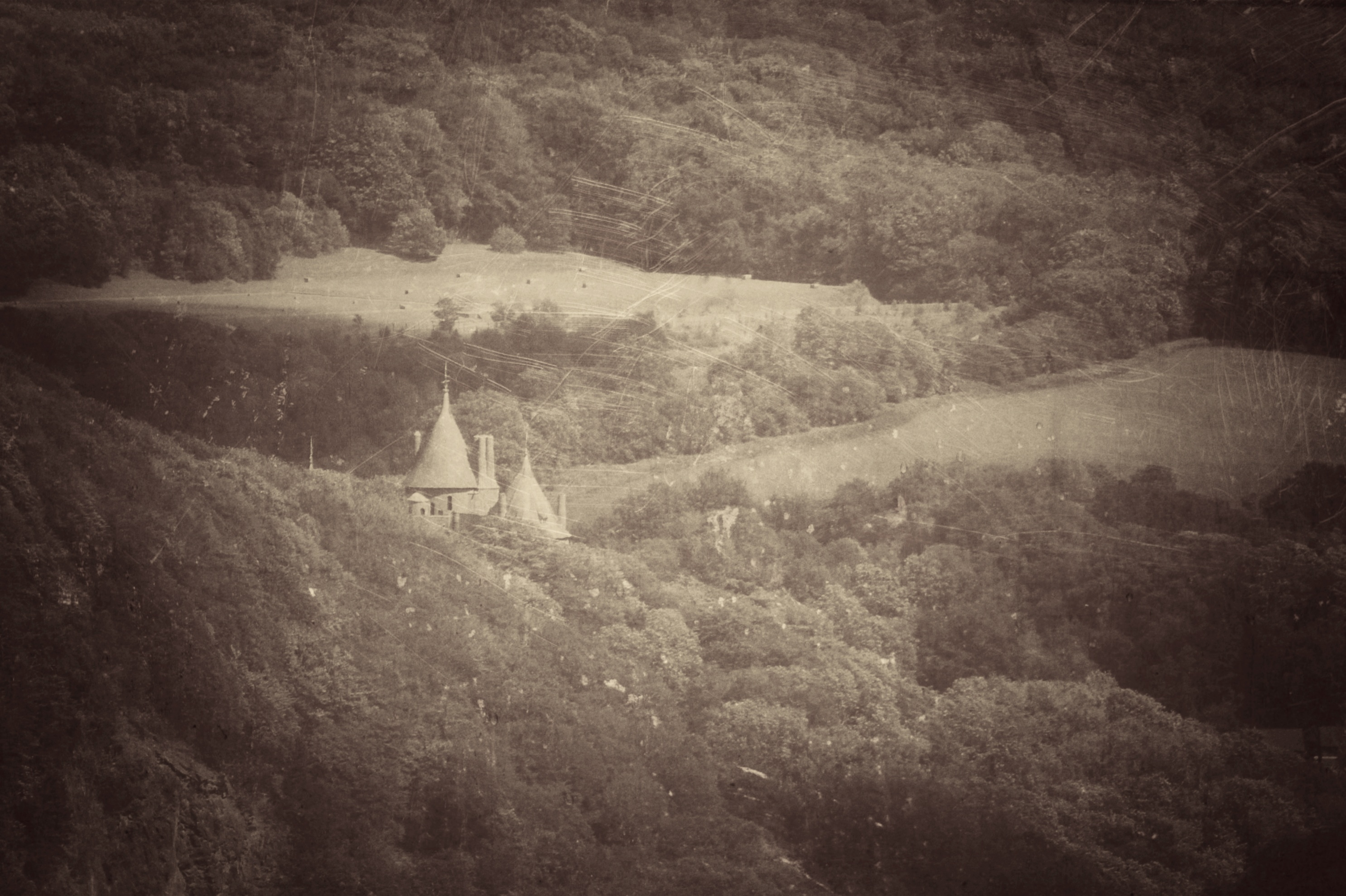 Black and white photo of Castell Coch with scratches