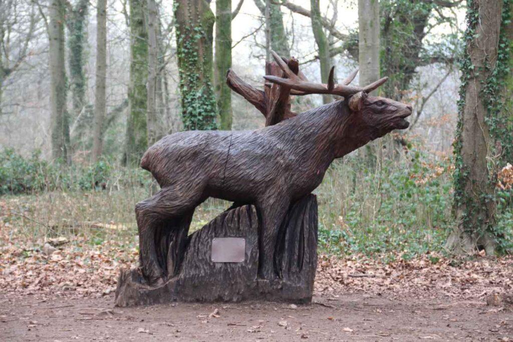 Wooden sculpture of a red deer